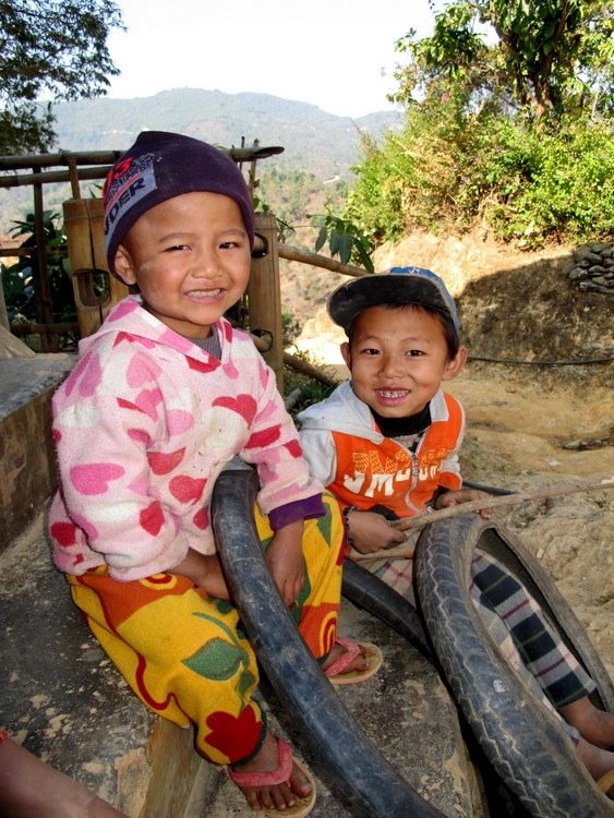 Little Palaung boys with tires and sticks