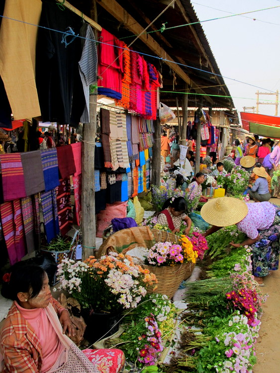 Selling flowers at a market on Inle Lake, Myanmar