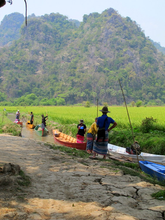 Boat ride outside a cave in Hpaan, Myanmar