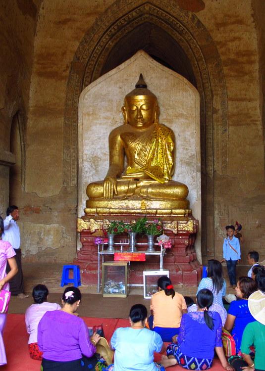 worshipping inside a paya in Bagan, Myanmar